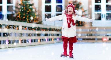 Kind auf der Eisbahn